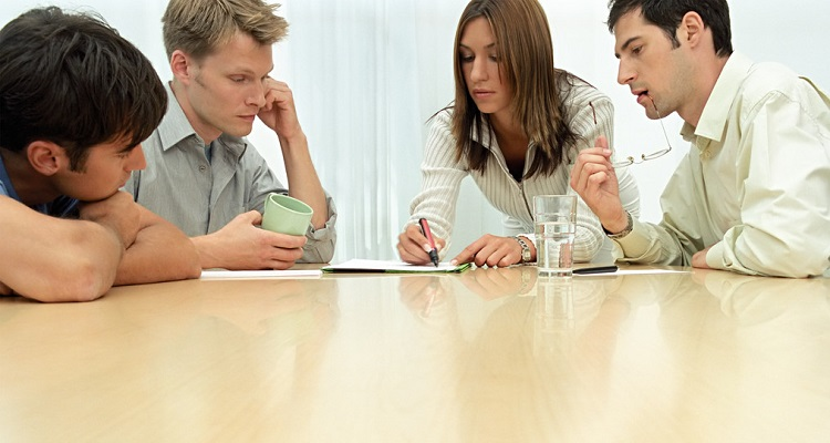 Office workers in meeting --- Image by © Royalty-Free/Corbis